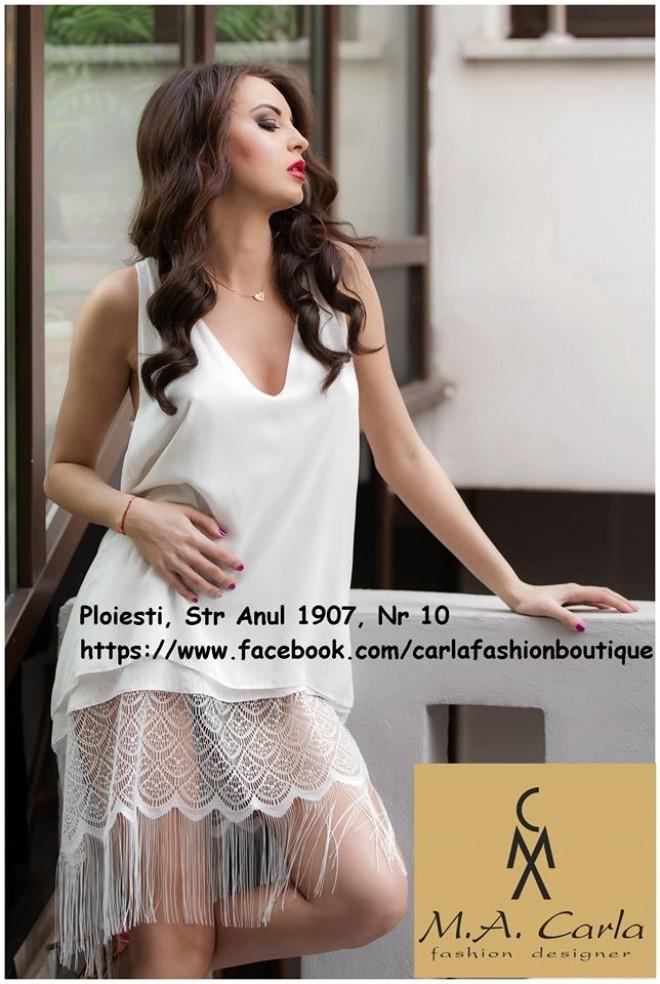 Câștigă SUPER SIMPLU rochia din imagine, semnată Carla Modrișan