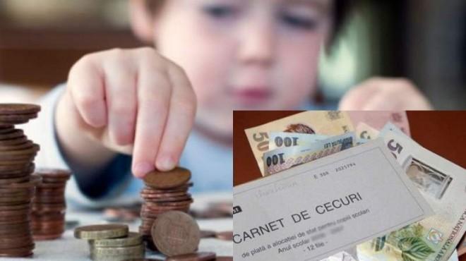 Alocațiile ar putea fi înlocuite cu vouchere Orban vrea ca banii sa nu mai poata fi folositi in interesul parintilor