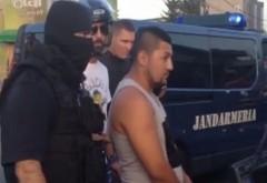 Trei romi cu un BMW au şicanat un motociclist la intrarea în Piteşti. Coşmarul lor a început după ce l-au dărâmat şi au coborât la el înarmaţi. VIDEO