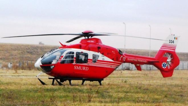 Accident INFIORATOR, in Prahova: Un tanar care muncea pe camp a ramas cu picioarele amputate de la genunchi. A intervenit elicopterul SMURD