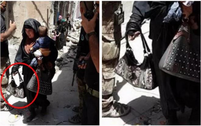 Imagini CUTREMURĂTOARE cu o femeie care ţine în braţe un bebeluş, cu doar câteva clipe înainte de a DETONA o BOMBĂ