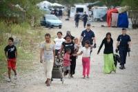Belgienii au găsit solutia prin care au scapat de tigani. Tabără de romi, pusă pe fugă cu muzica DUBSTEP! =))