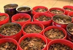 A depus la banca 226 de kilograme de monede. Cat valoreaza banii si in cat timp i-a numarat casierul