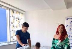 Primele imagini cu Elena Gheorghe si micuta ei, la externare! Artista arata de senzatie la doar 4 zile dupa ce a nascut
