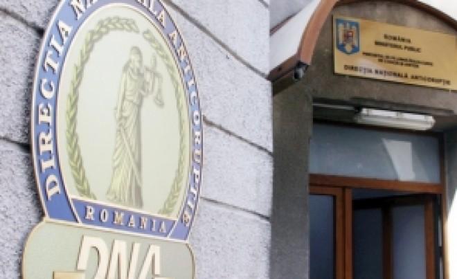 DNA ancheteaza 'drumul lui Boc'. 2 milioane de euro furate din asfaltarea a 2 km
