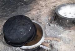 VIDEO TRIST - O văduvă a fiert pietre pentru copiii ei infometati, în speranţa că ii va pacali si vor adormi asteptand să mănânce