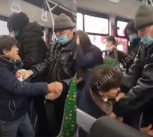 Bataie in autobuz: O femeie care purta masca sub barbie a fost palmuita de un barbat cu masca... sub nas!