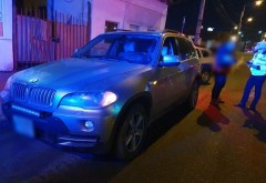 Un BMW X5 furat în urmă cu puțin timp din București, oprit în trafic de polițiști ploieșteni