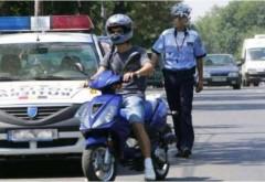 Minor prins de poliţişti în timp ce conducea motociclul bunicului